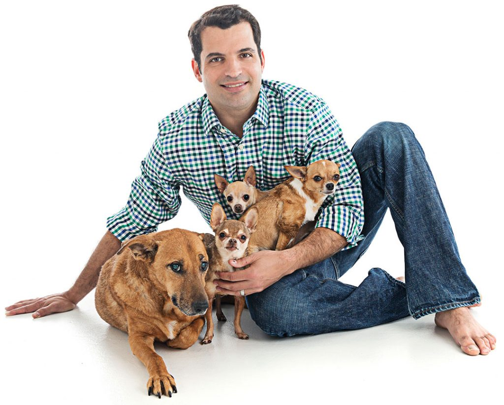 Dr. Marchan with 4 of his dogs