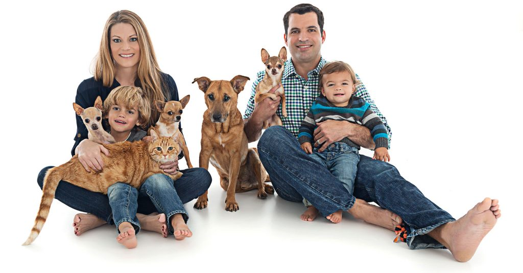 Dr. Marchan and Dr. Bierens with their kids and pets